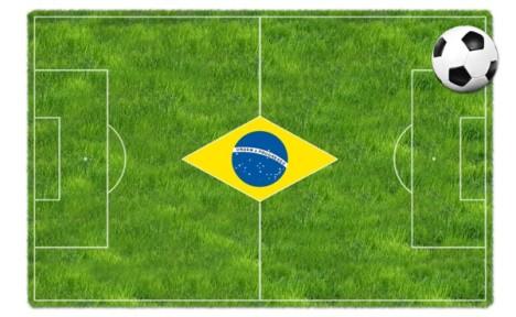 Wiese mit Fahne Brasilien und Fußball
